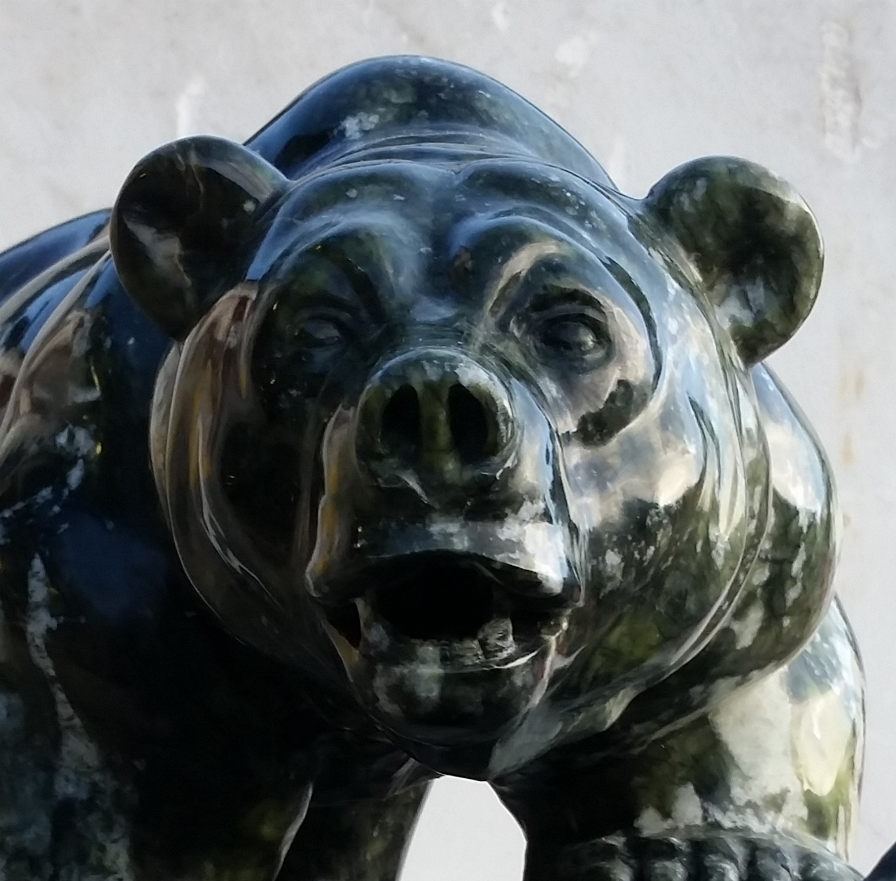 Original stone sculpture grizzly bear by andrew gable